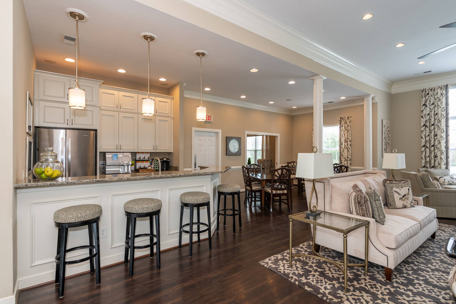 Luxury clubhouse kitchen with stainless appliances, granite countertops, and gourmet coffee maker.
